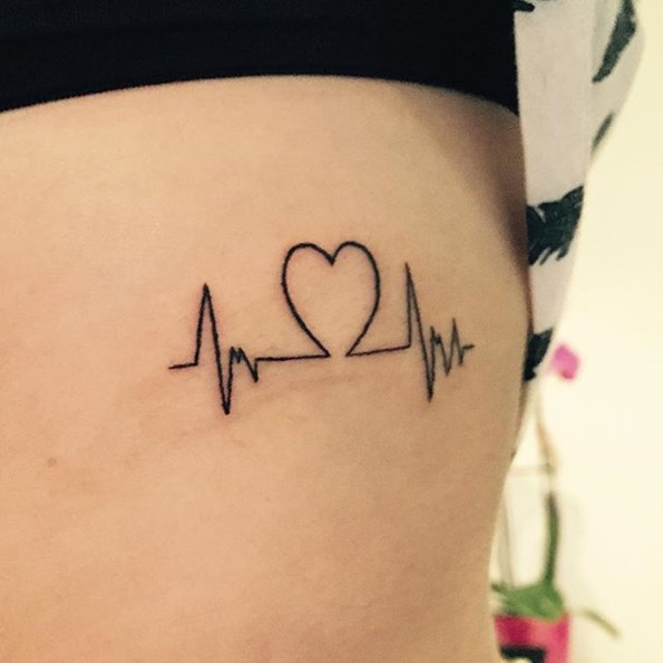 heart with lifeline tattoo ribs