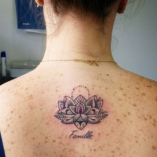 lotus flower tattoo tribute to family on back