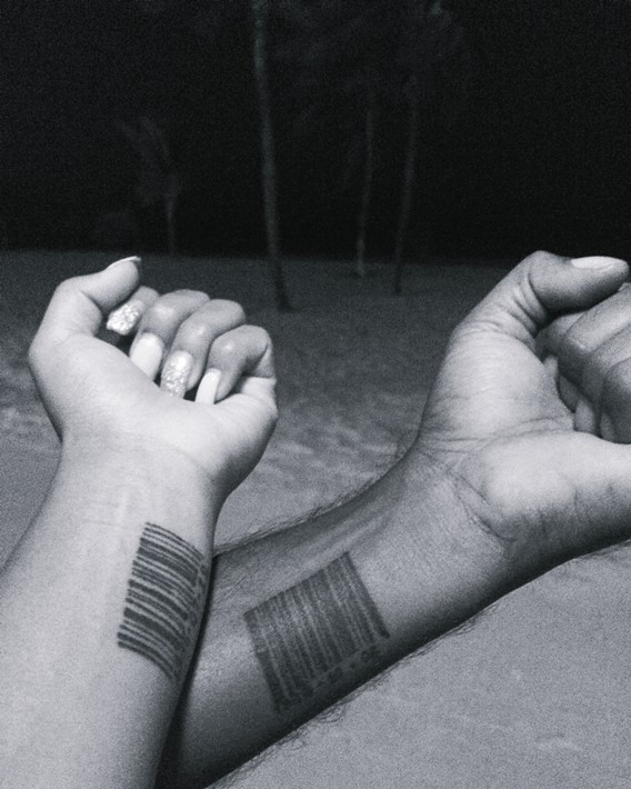 matching his and hers barcode tattoos