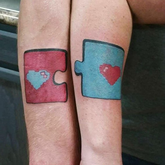 matching his and hers puzzles tattoos