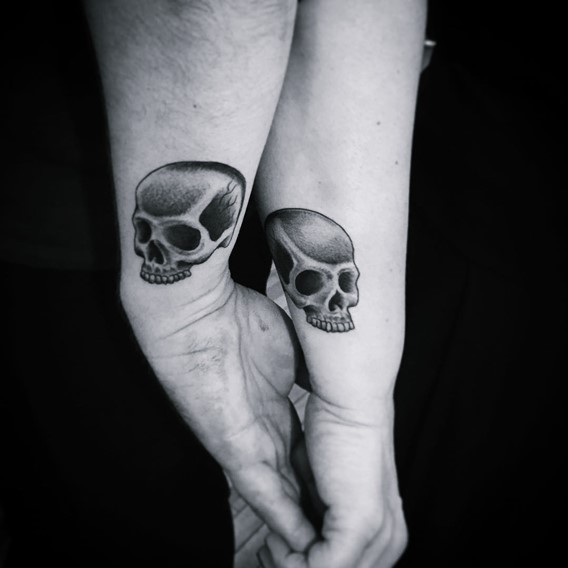 matching his and hers skull tattoos