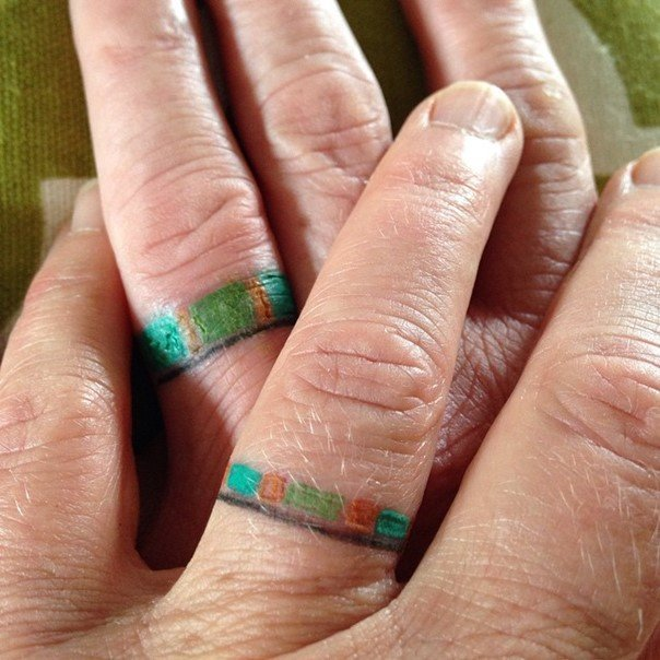 matching wedding ring finger tattoos