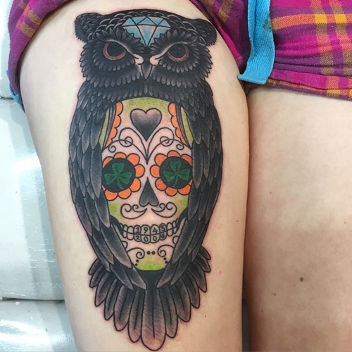 mexican skull with owl tattoo on thigh