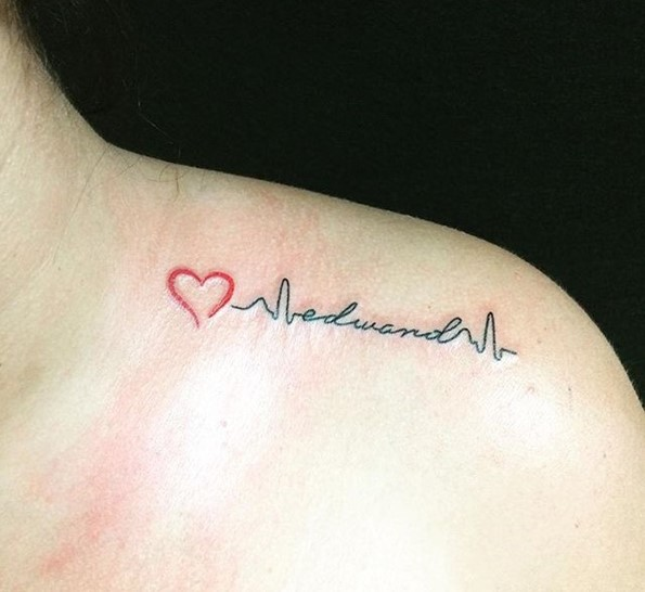 red heart with lifeline tattoo on shoulder