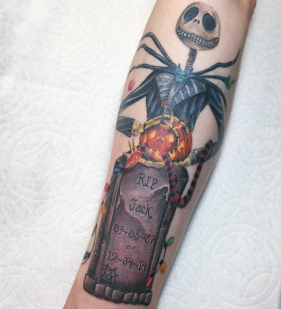 tattoos of nightmare before christmas with tombstone and christmas lights