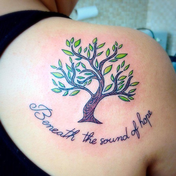 tree tattoos with words on back