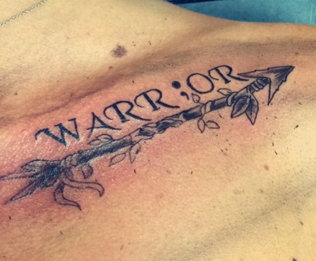 warrior semicolon collar bone tattoo male