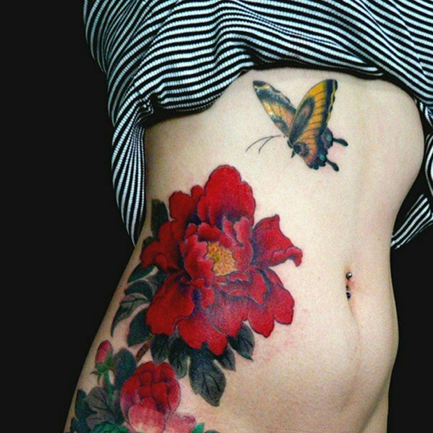 red flowers side tattoos for girls