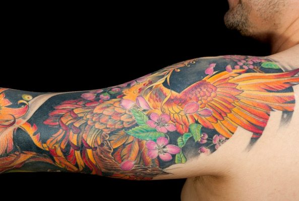 how much does an upper arm tattoo cost